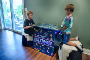 Kids playing in basement game room